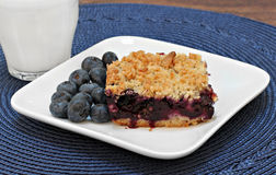 Blueberry bar cookie and milk. Stock Photography