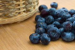 Blueberry with basket. On wood table stock image