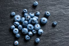 Blueberry on black slate. Close up. Top view. High resolution product Stock Photos