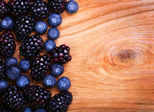 Blueberry and Blackberry on Wooden. Background Royalty Free Stock Photography