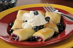 Blueberry blintzes with shipped cream Royalty Free Stock Photos