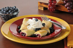 Blueberry blintzes with whipped cream Royalty Free Stock Photography
