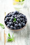 Blueberry, blueberries, fresh berry, berries, bilberry, bilberries served in a ceramic bowl on wooden background. Stock Image