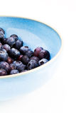 Blueberry bowl. A bowl of fresh blueberries high contrast on white Royalty Free Stock Photo