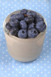 Blueberry in a bowl on blue dotted cloth. Blueberry antioxidant organic superfood in a bowl concept for healthy eating and nutrition Royalty Free Stock Photos