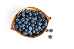 Blueberry in bowl on white Stock Photography