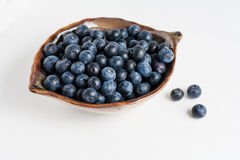 Blueberry in bowl on white Royalty Free Stock Photo