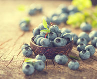Blueberry in bowl on wooden table background Royalty Free Stock Images