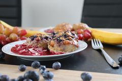 Blueberry breakfast muffins with sauce royalty free stock photo