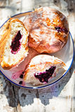 Blueberry buns on white plate on summer table Royalty Free Stock Photos