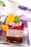 Blueberry cake. With whipped cream and orange decoration royalty free stock photo