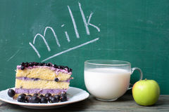 Blueberry cake with apple and milk word Royalty Free Stock Photos
