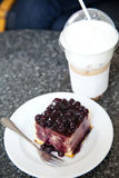 Blueberry cake and capuchino ice coffee Royalty Free Stock Photography