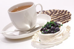Blueberry cake with a cup of tea and biscuit. Blueberry cake with a cup of tea and chocolate biscuits Stock Image