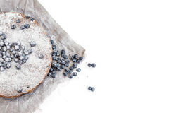 Blueberry cake with fresh bluberries and sugar powder on a beige Stock Images