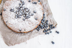 Blueberry cake with fresh blueberries and sugar powder on a beig Stock Image