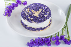 Blueberry cake shu decorated with purple flowers of statice Royalty Free Stock Photography