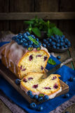 Blueberry cake with sugar icing and fresh berries Stock Photo