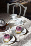 Blueberry cakes and tea on the table. Still life. royalty free stock photos
