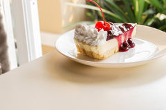 Blueberry cheese cake with cherry on top Stock Photos