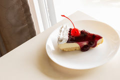 Blueberry cheese cake with cherry on top Royalty Free Stock Photos