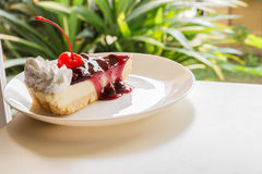 Blueberry cheese cake with cherry on top Royalty Free Stock Image