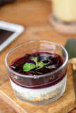 Blueberry Cheese Cake in the glass bowl. Blueberry Cheese Cake in the glass bowl on wood plate Stock Images