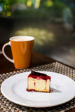 Blueberry cheese cake. On the white plate Royalty Free Stock Photos