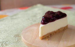 Blueberry cheese cake on wood plate Royalty Free Stock Photos