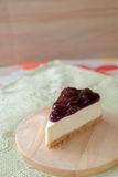 Blueberry cheese cake on wood plate. Home made blueberry cheese cake on wood plate Royalty Free Stock Photo