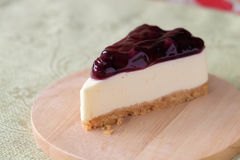 Blueberry cheese cake on wood plate. Home made blueberry cheese cake on wood plate Royalty Free Stock Photos