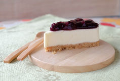 Blueberry cheese cake on wood plate. Home made blueberry cheese cake on wood plate Royalty Free Stock Images