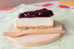 Blueberry cheese cake on wood plate. Home made blueberry cheese cake on wood plate Stock Photo