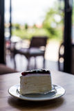 Blueberry cheese cake on wooden table Royalty Free Stock Image
