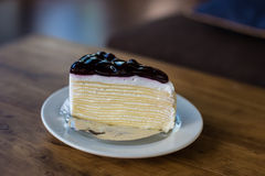 Blueberry cheese cake on wooden table Royalty Free Stock Photography