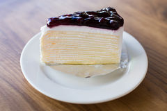 Blueberry cheese cake on wooden table Royalty Free Stock Images