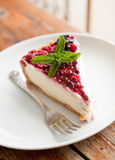 Blueberry Cheesecake. Blueberry fridge cheesecake on white plate, with mint leaves as garnish Stock Image