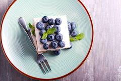 Blueberry cheesecake bars on blue plate Stock Photography