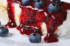 Blueberry cheesecake with berry sauce on a plate macro Stock Image