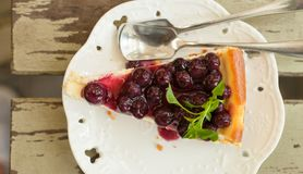 Blueberry cheesecake. Slice on the wood table Royalty Free Stock Photography