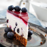 Blueberry cheesecake. Close up of homemade blueberry cheesecake, selective focus Royalty Free Stock Photos
