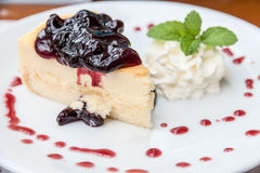 Blueberry cheesecake. With cream, decorate with blueberry syrup Royalty Free Stock Images