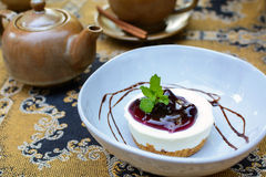 Blueberry cheesecake with cup of tea and kettle Stock Images