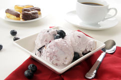 Blueberry cheesecake ice cream with eclairs Stock Photo