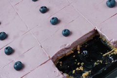 Blueberry cheesecake. Pink with blueberries on top. Royalty Free Stock Images