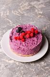 Blueberry cheesecake on a plate. Blueberry cheesecake, close up, vertical, top view Stock Photo