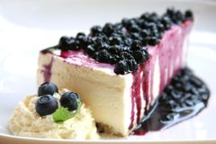 Blueberry cheesecake slice stock photography
