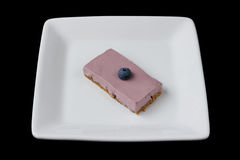 Blueberry cheesecake on a white plate isolated on black Stock Photo