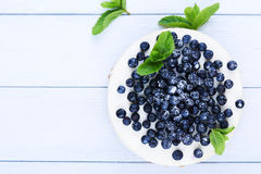 Blueberry cheesecake on a white wooden background Royalty Free Stock Images