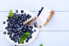 Blueberry cheesecake on a white wooden background Stock Photo